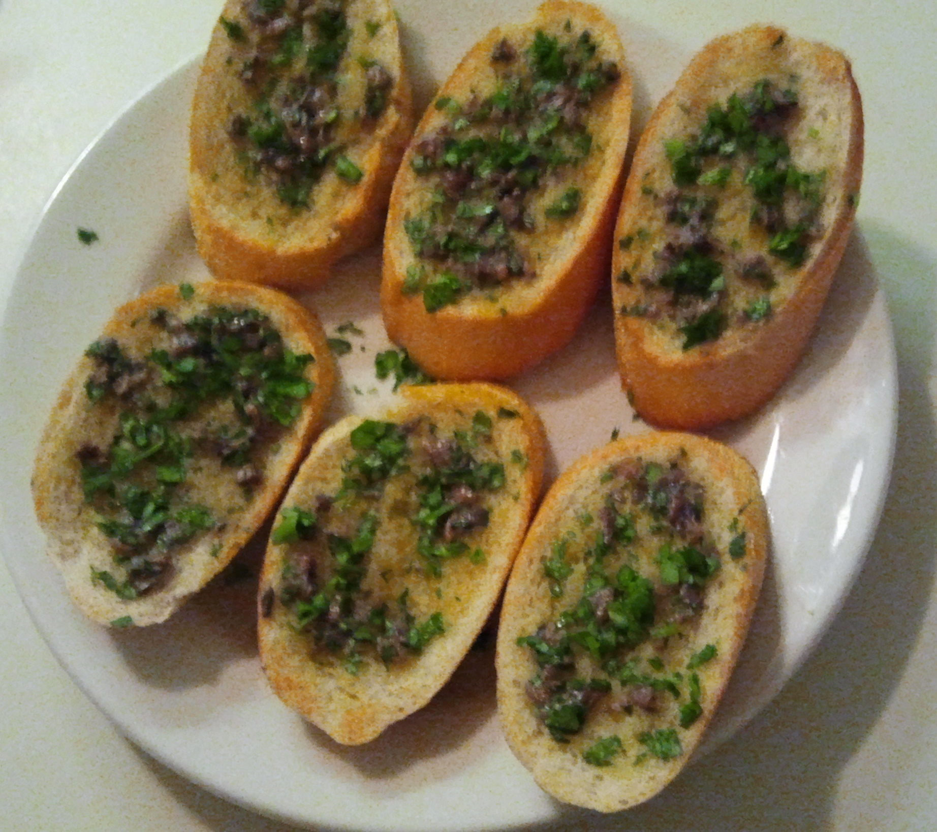 From the cookbook #2: Garlic and anchovy toasts, page 62 ...
